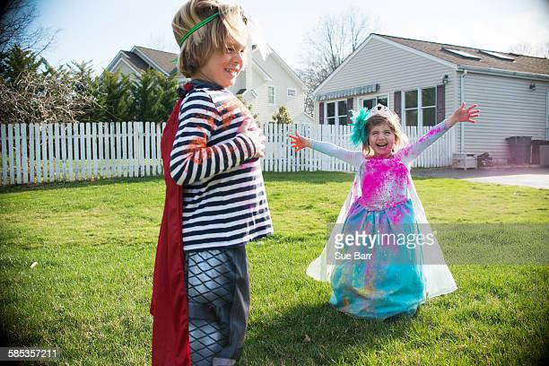 Children in costumes playing outdoors