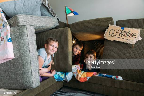 children in couch fort - quarantine stock pictures, royalty-free photos & images