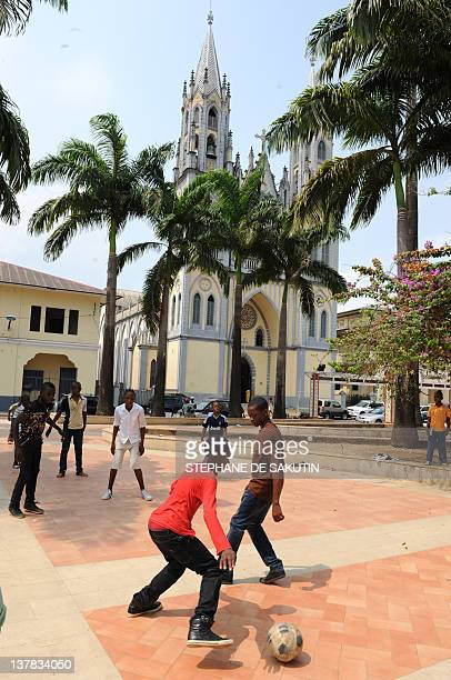 Children in down town Malabo playing football on January 28 2012 before Equatorial Guinea takes on Zambia in The African Cup of Nations AFP PHOTO /...