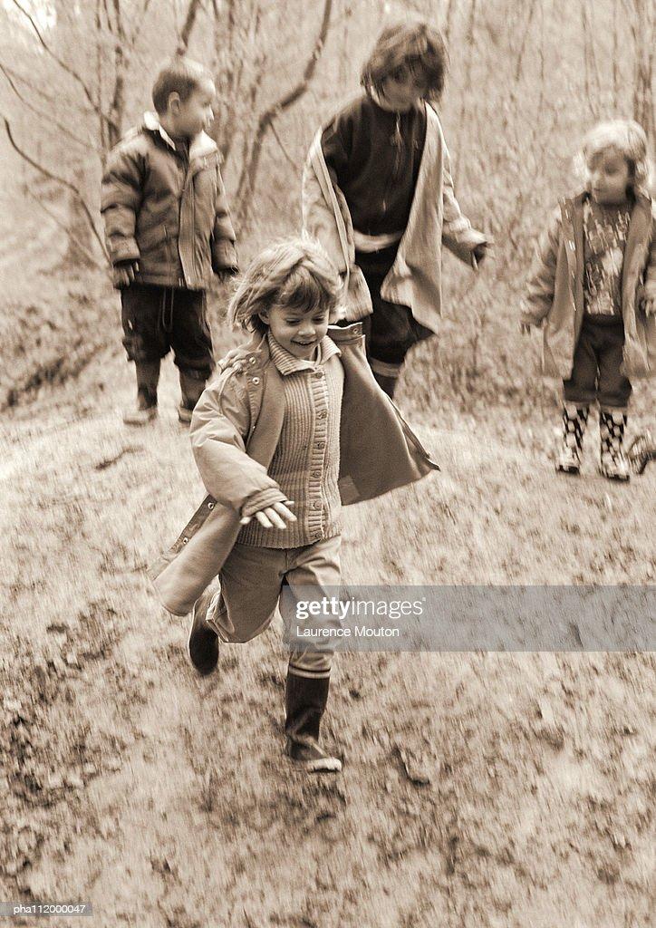 Children in forest, b&w : Stockfoto