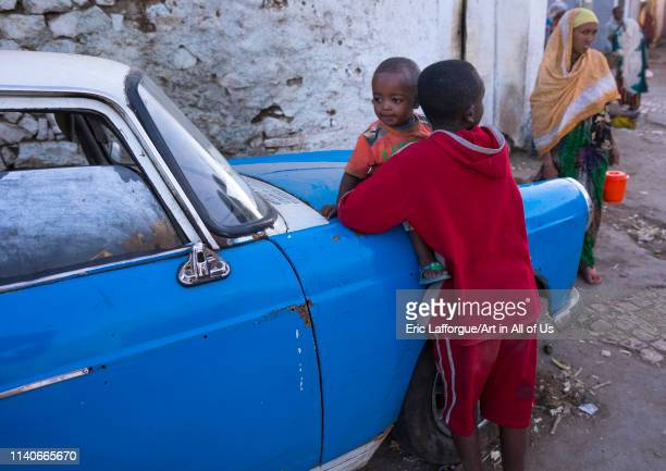 Children in front of an old peugeot 404 Harar Ethiopia on January 10 2014 in Harar Ethiopia