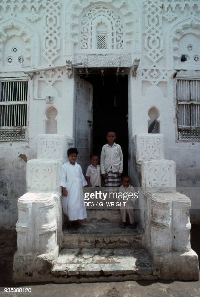 Children in front of the door of a traditional house Zabid Al Hudaydah province Yemen