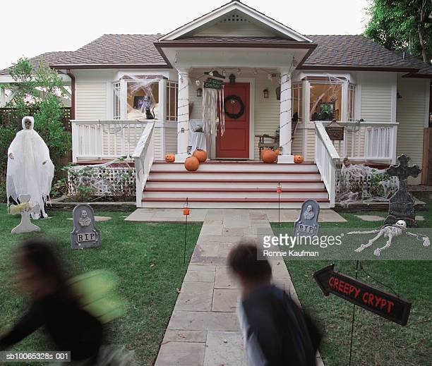 children (4-5) in halloween costume running at house - naughty halloween stock photos and pictures