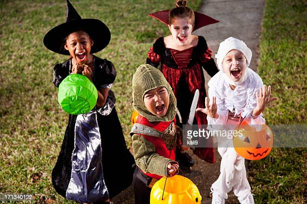 children in halloween costumes - halloween kids stock photos and pictures