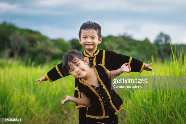 children in kadazan dusun ethnic costumes in borneo - harvest festival stock pictures, royalty-free photos & images