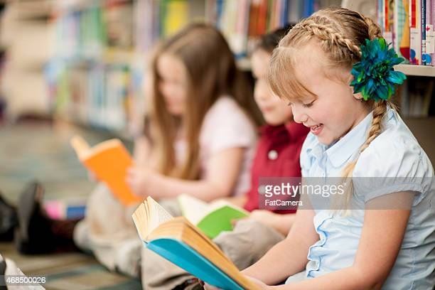 children in library - library stock photos and pictures