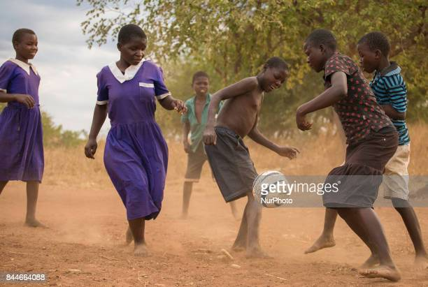 Children in Malawi play a game of football after having a bible study together