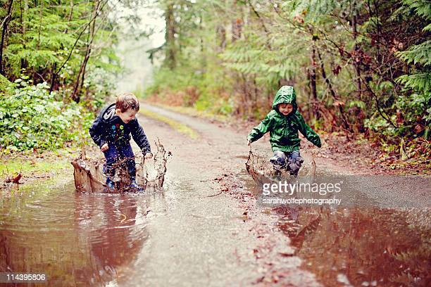 Children in mud puddles