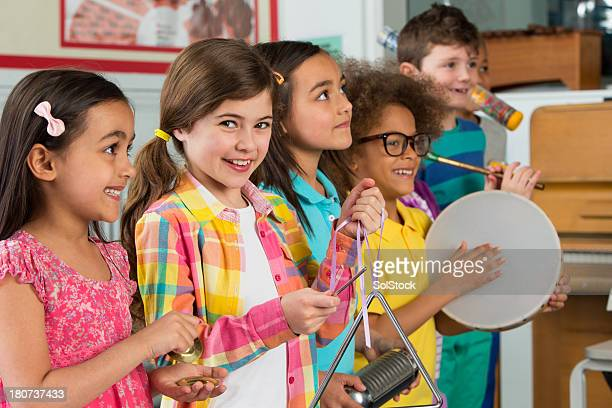 children in music class - musical equipment stock pictures, royalty-free photos & images
