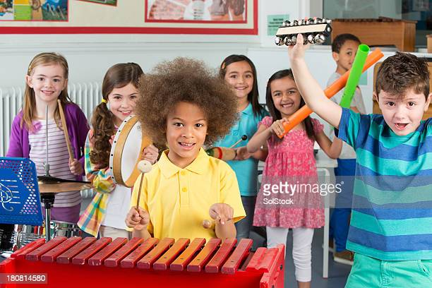children in music class - percussion instrument stock photos and pictures