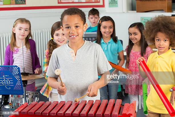 children in music class - glockenspiel stock photos and pictures