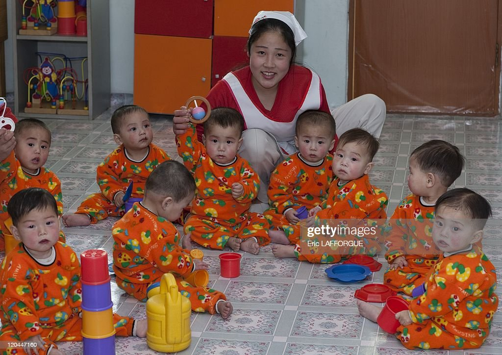 Children in Nampo, North Korea on April 14, 2008 - The Nampho orphanage that is shown to visitors is brand new, the babies and kids are full of life, playing with tons of toys. But this it is not a orphanage like in western countries, because most of the kids do have parents. But parents, who do not have enough money, put their babies here. That is the official speech. There is a lot of twins, and even some triplets in the orphanage. One more time, the official explanation is: when a couple has got twins, he cannot afford to educate them, so the government takes care of them.
