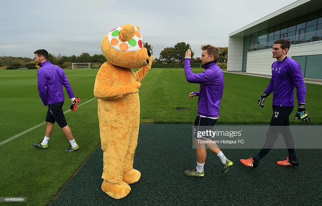 Children In Need's Pudsey Bear meets players at the club's training ground on October 28, 2015 in Enfield, England.