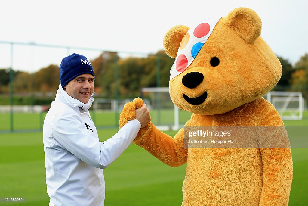 Children In Need's Pudsey Bear meets Tottenham Manager Mauricio Pochettino at the club's training ground on October 28, 2015 in Enfield, England.
