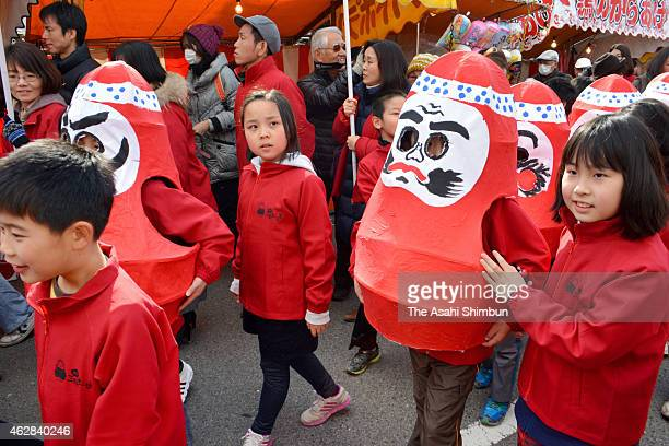 Children in papiermache Daruma dolls march on at the ShinmeiIchi market on February 6 2015 in Mihara Hiroshima Japan The event was revived after a...