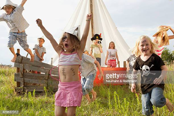 Children (5-6, 7-9) in pirate costume