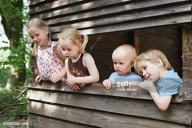 Children in playhouse