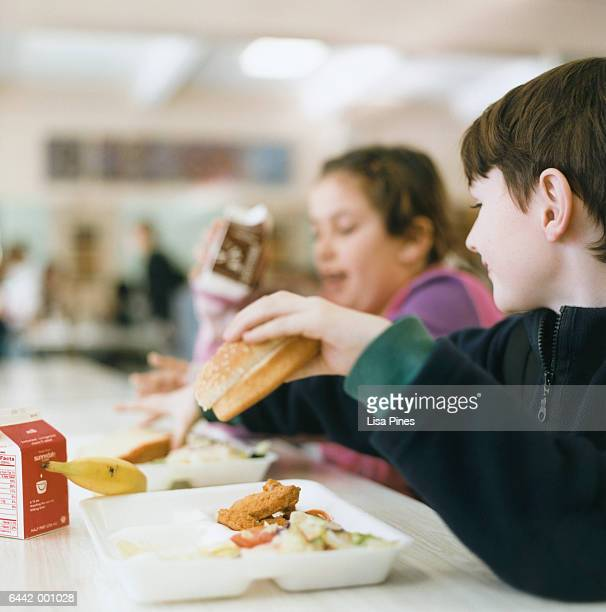 children in school cafeteria - milk carton stock photos and pictures
