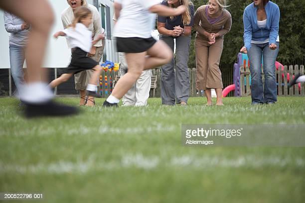 Children (4-8) in school sports day race (blurred motion)
