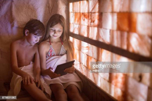children in spa center - himalayan salt stock pictures, royalty-free photos & images