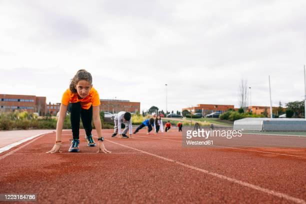 children in starting postion, preparing for a race - atletismo imagens e fotografias de stock