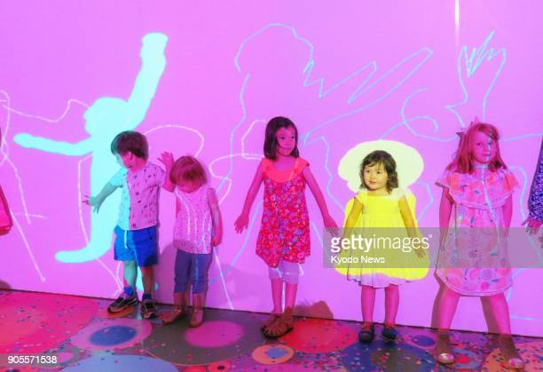Children in Sydney participate on Jan 16 in Join the Dots an interactive digital art project allowing them to create art in real time with children...