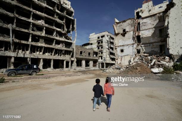 TOWN LIBYA JANUARY 31 2019 Children in the damaged building located in Benghazi's Old Town on January 312019 in Libya After the Libyan revolution in...