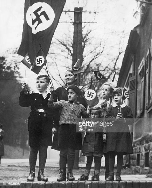 Children in the German Saarland wave flags in support of the Nazi Party 1934