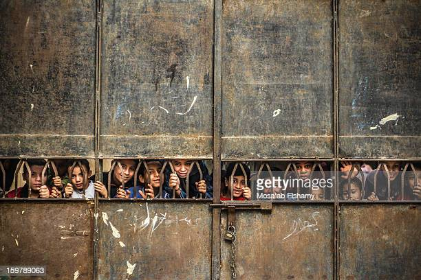 CONTENT] Children in the impoverished area if Khosoos look through the gates of one of the area's public schools Over 40% of the country is below...