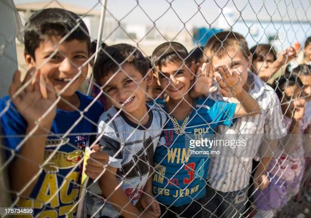 Children in the refugee camp Domiz at the SyrianIraqi border on August 4 2013 in Dohuk Iraq