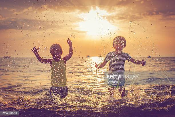 Children in the sea, focus on drops