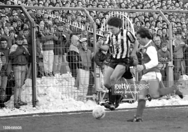 Children in the west stand paddock improvise for a better viewing point through the security fence by standing on the snow as Peter Beardsley is...