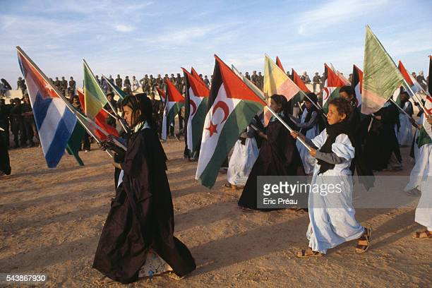 Children in the Western Sahara carry the Polisario Front flags and colors as they parade The acronym stands for Frente Popular de Liberacion de...