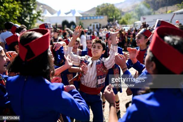 Children in traditional attire dance during the Areni Wine Festival, some 120 km from Yerevan, on October 7, 2017. / AFP PHOTO / Kirill KUDRYAVTSEV