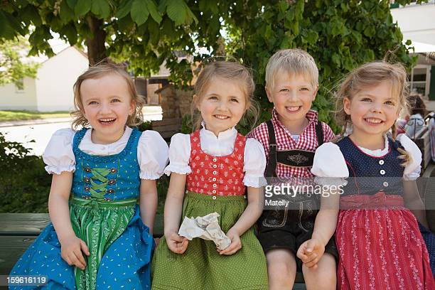 children in traditional bavarian clothes - knickers photos et images de collection