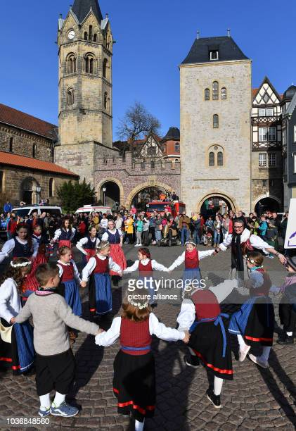 Children in traditional costume dance during the traditional spring festival parade in Eisenach Germany 25 March 2017 This year's theme is '500 years...
