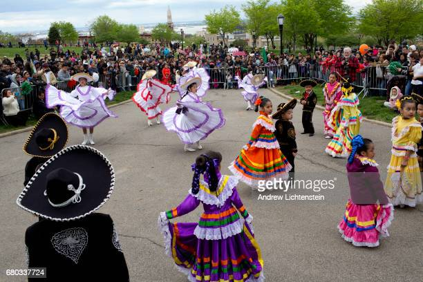 Children in traditional dress gather for Cinco de Mayo festivities in the Sunset Park neighborhood during a Cinco de Mayo parade on May 7 2017 in...