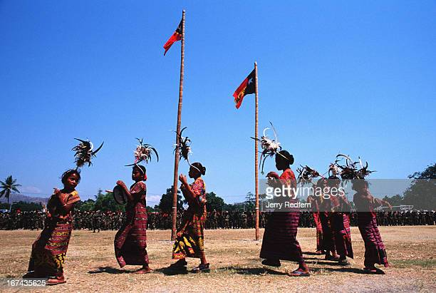 Children in traditional Timorese dress dance around the Timorese flag at a parade honoring the anniversary of the founding of Falintil The longtime...