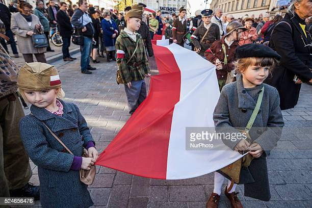 Children in Warsaw streets dressed as II World War in the main front of the march in memory of the more than 20000 polish people killed in Katyn...