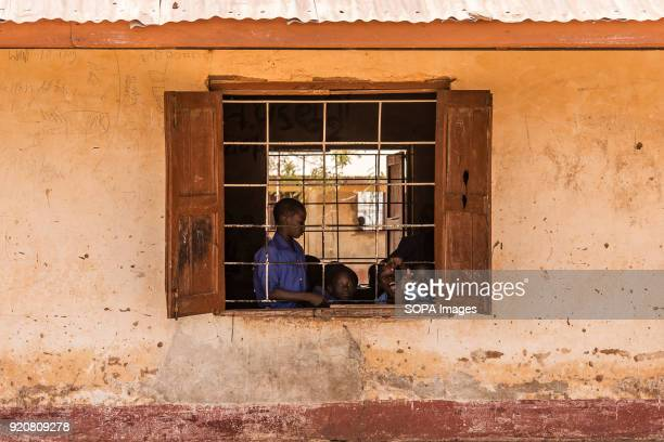 Children inside a school next to TimTooni Football Club, just outside Tamale in Northern Ghana. Along with football coaches from London, time was...