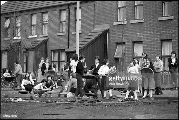 Children join in a 'noise barrage' against British soldiers in the republican Short Strand district of Belfast 21st May 1981