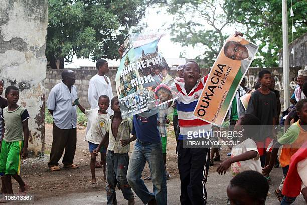 Children join supporters of a Comoros Presidential candidate during a rally in Moheli on November 2 2010 The governors of the archipelago's three...