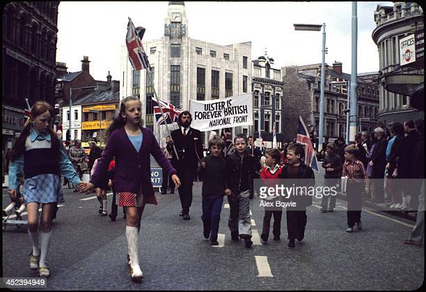 Children join the vanguard of a proBritish National Front demonstration as they march down Royal Ave Belfast 2 September 1971