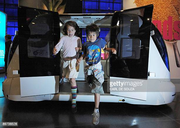 Children jump from a driverless car during a photocall at the Science Museum in London on August 11 2009 The photocall was held to promote a new...