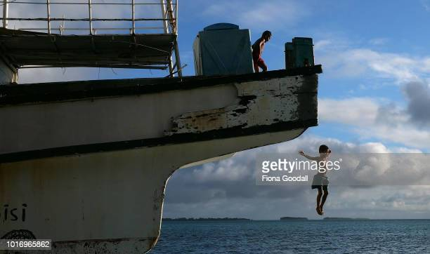 Children jump off a shipwreck into the lagoon on August 15 2018 in Funafuti Tuvalu The ship was the victim of a cyclone and now sits on the shoreline...