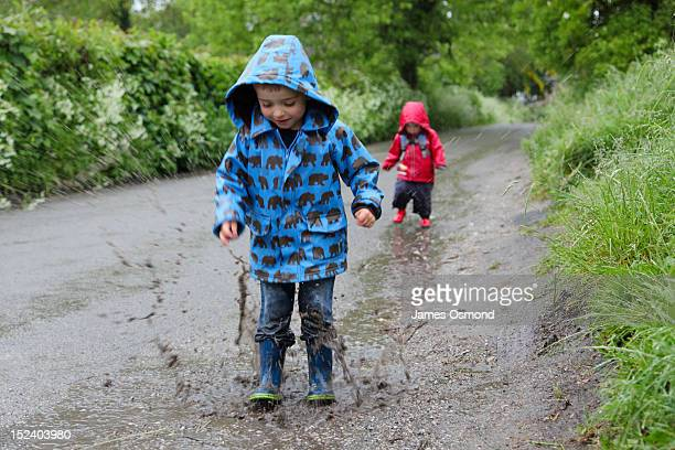 Children jumping in puddles.