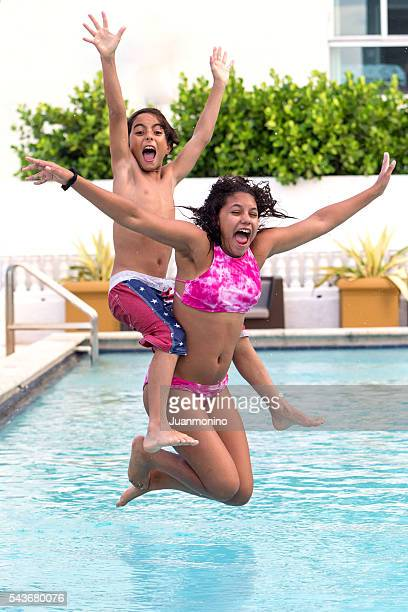 children jumping into a swimming pool - 13 year old black girl stock photos and pictures
