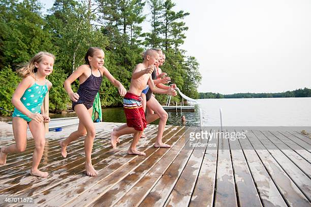 Children Jumping into Lake