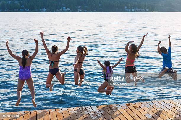 children jumping into lake - chinese bikini girls stock pictures, royalty-free photos & images