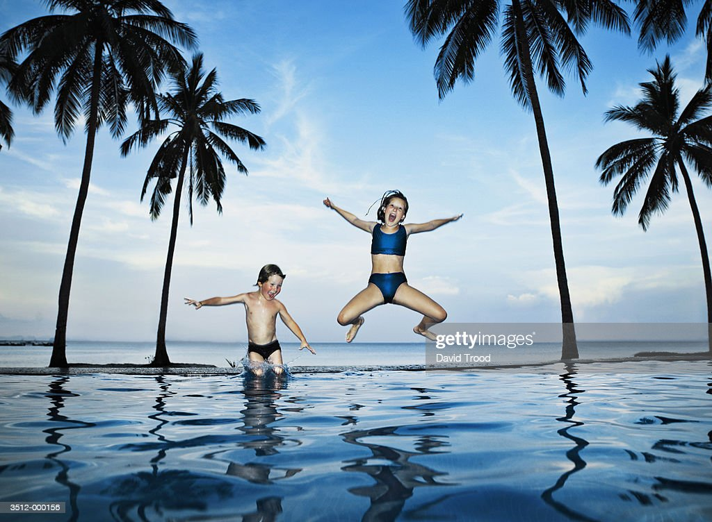 Children Jumping into Pool : Stock Photo